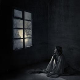Girl in a dark room